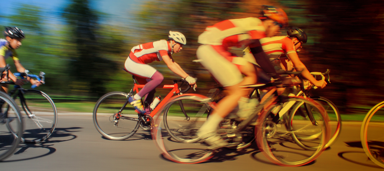 background bicyclists showing speed and dynamic movement